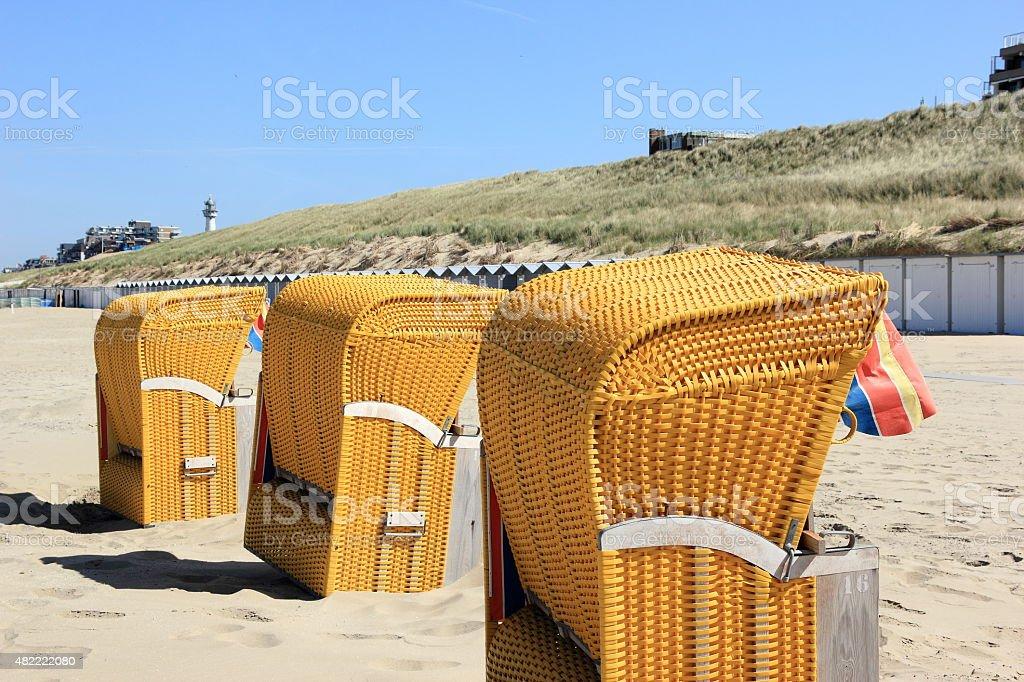 Roofed wicker beach chairs. Egmond aan Zee, North Sea, Netherlands. stock photo
