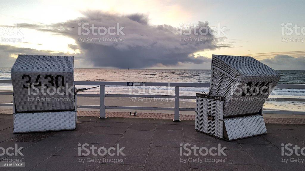 roofed wicker beach chairs stock photo