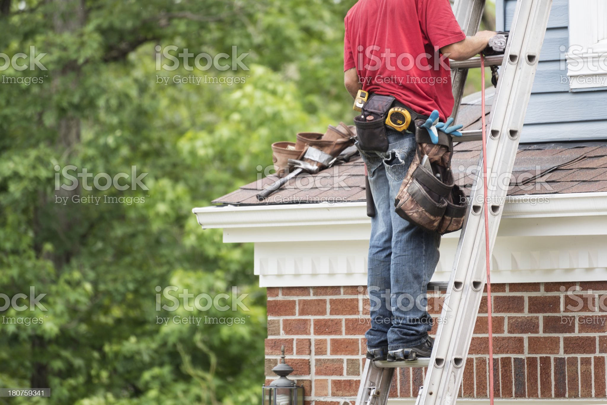 Roofer on a Ladder Horizontal with Copy Space royalty-free stock photo