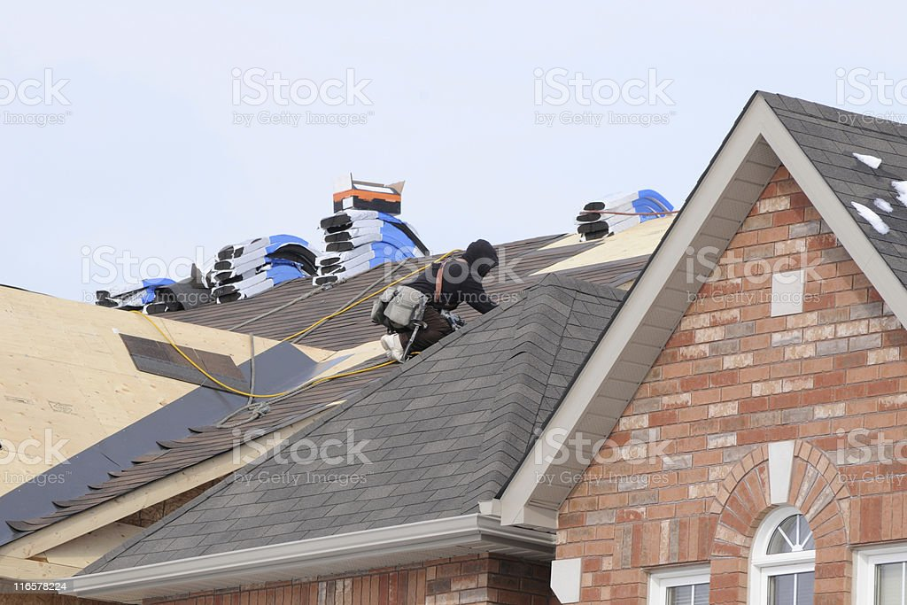 Roofer On The Job stock photo