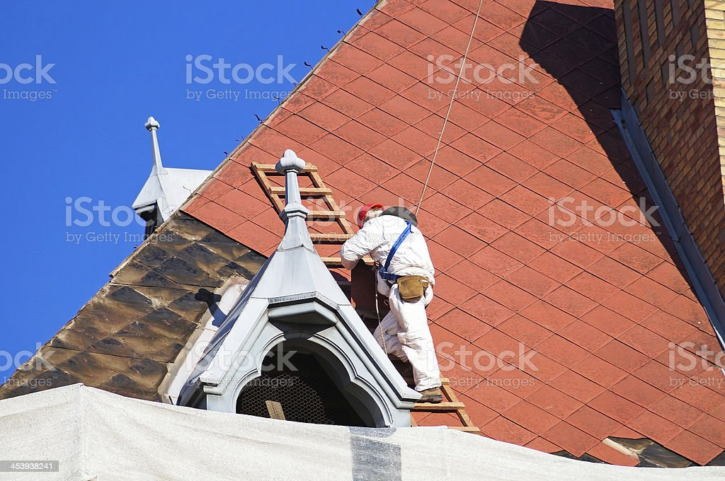 roofer on the roof royalty-free stock photo