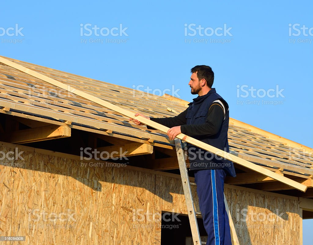 Roofer Working on Roof stock photo
