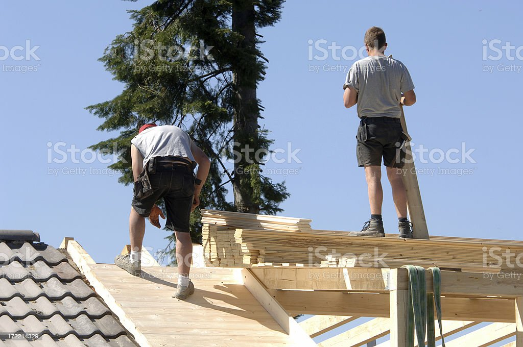 Roofers at work #4 stock photo