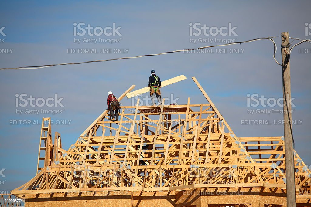Roofers building a new roof frame for a new house stock photo
