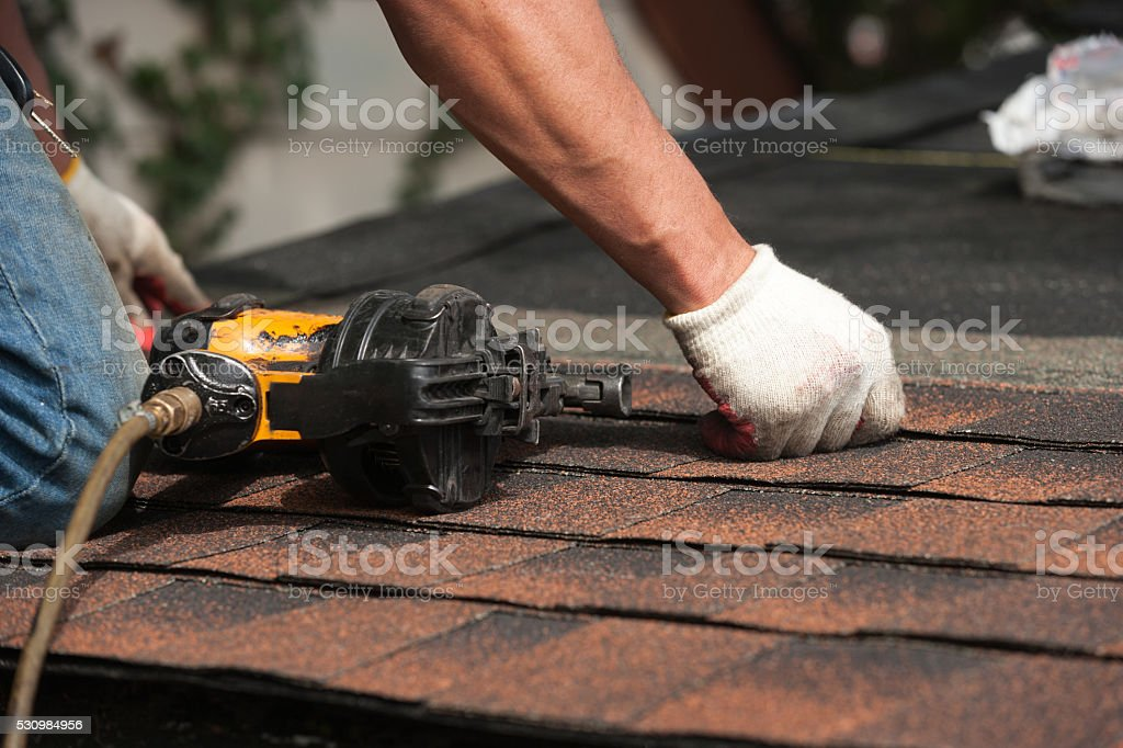 roofers installing new roof on house stock photo