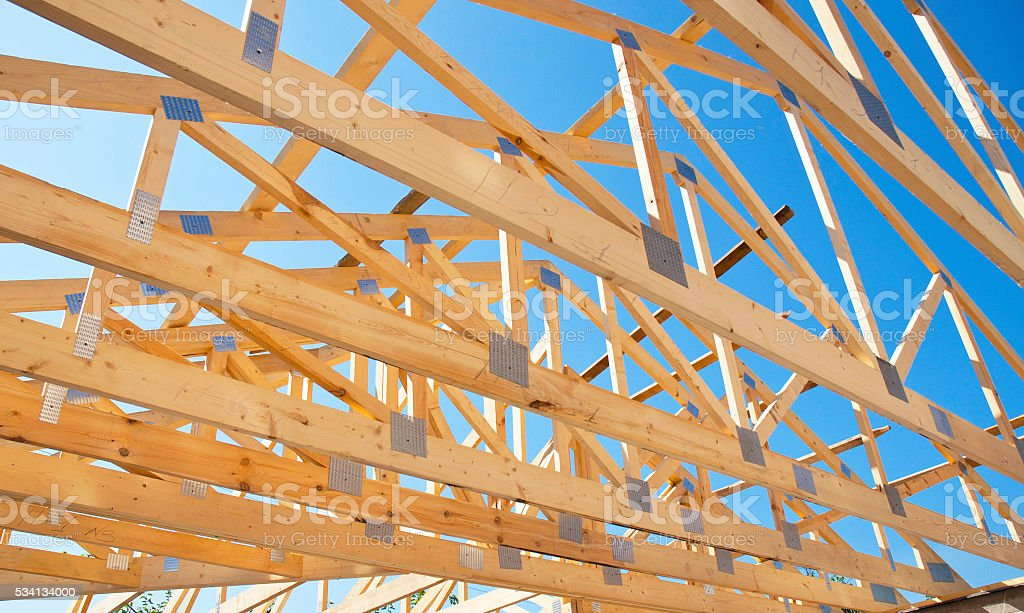 Roofing Construction. Roof Trusses of New Home Building Construction. stock photo