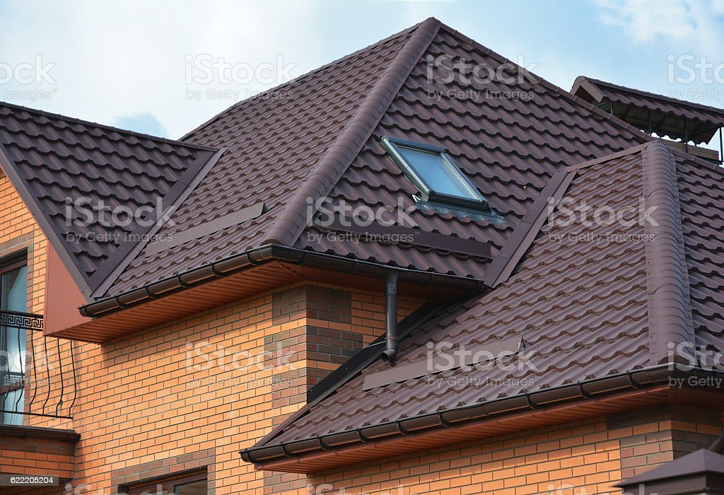 Roofing construction with attic skylights, rain gutter system stock photo