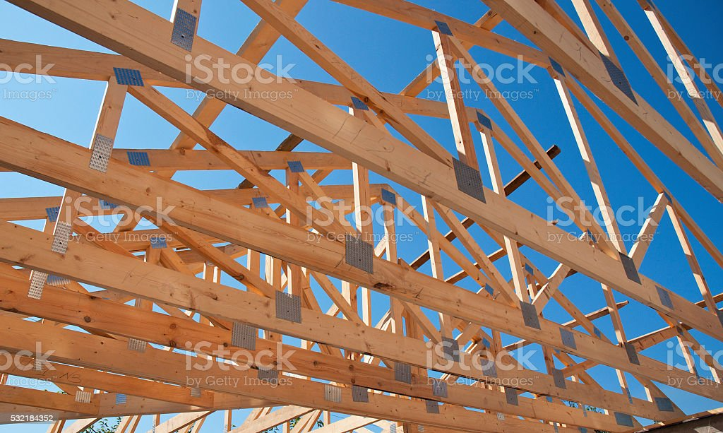 Roofing Construction. Wooden Roof Frame House Construction. stock photo