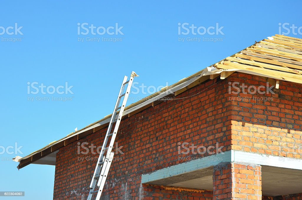 Roofing Construction. Wooden Roof Frame Unfinished House Construction stock photo