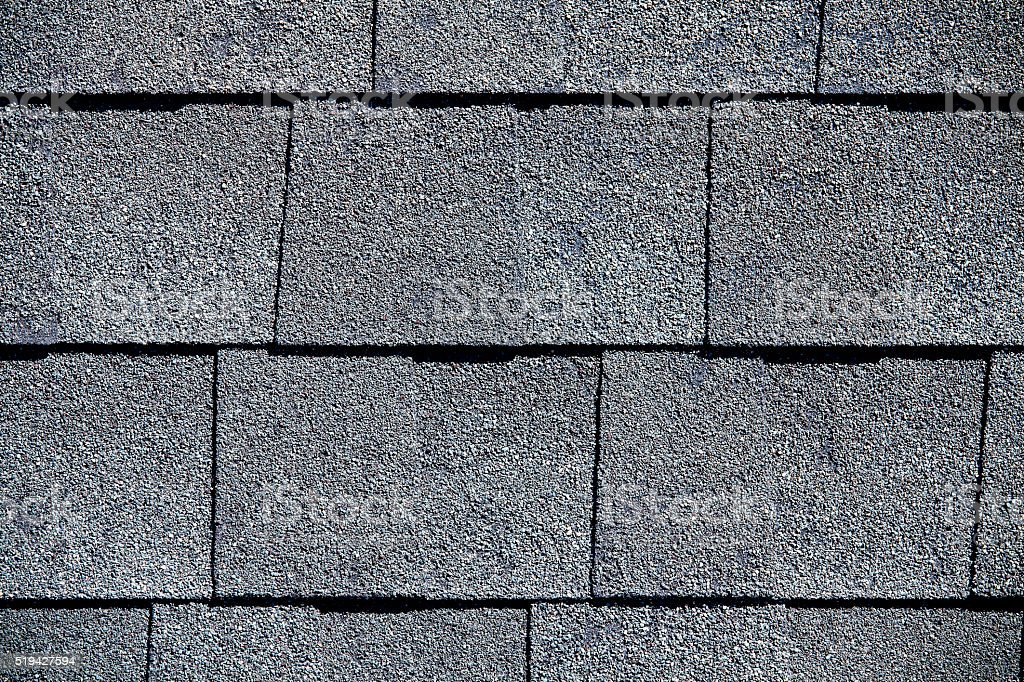 Roofing Shingles slate gray tab style pattern stock photo