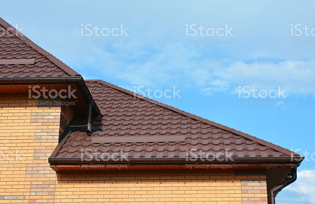 Roofing with New House Rain Gutter Waterproofing. Guttering Down pipe stock photo