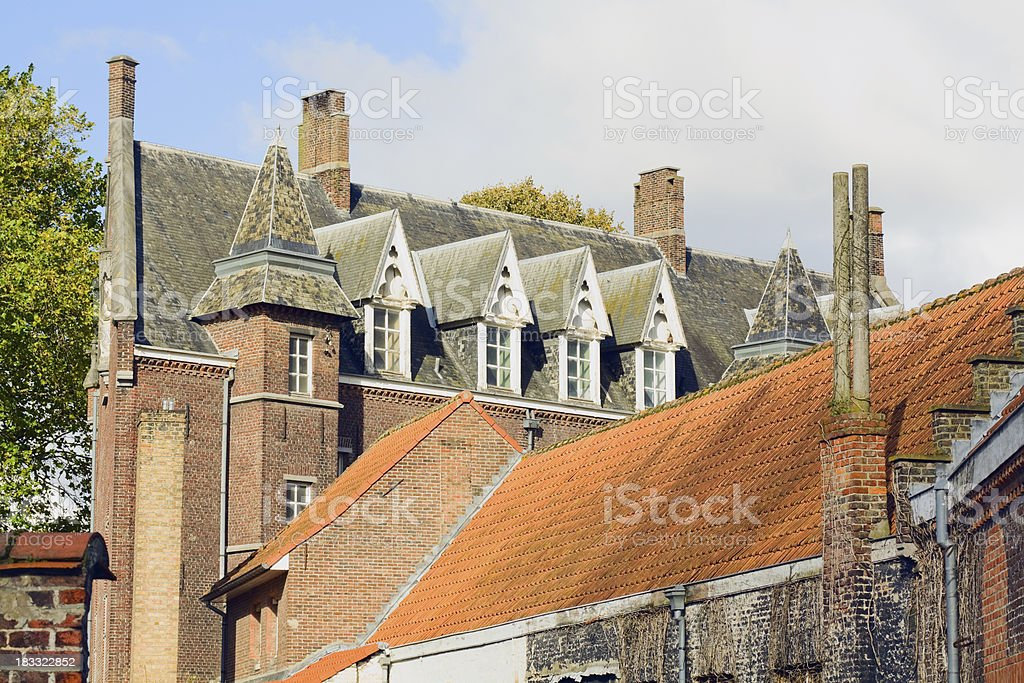 Roofs and chimneys of Bruge stock photo