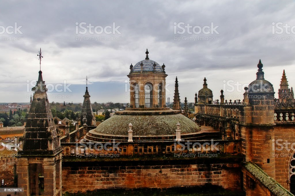 Roofs and courtyard of Seville Cathedral, or Cathedral of Saint Mary of the See (Catedral de Santa Maria de la Sede), as seen from the Giralda (La Giralda), the bell tower of the Cathedral, Seville, Andalusia, Spain stock photo