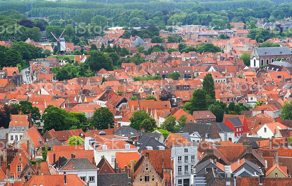 Roofs of Flemish Houses and windmill in Brugge, Belgium stock photo