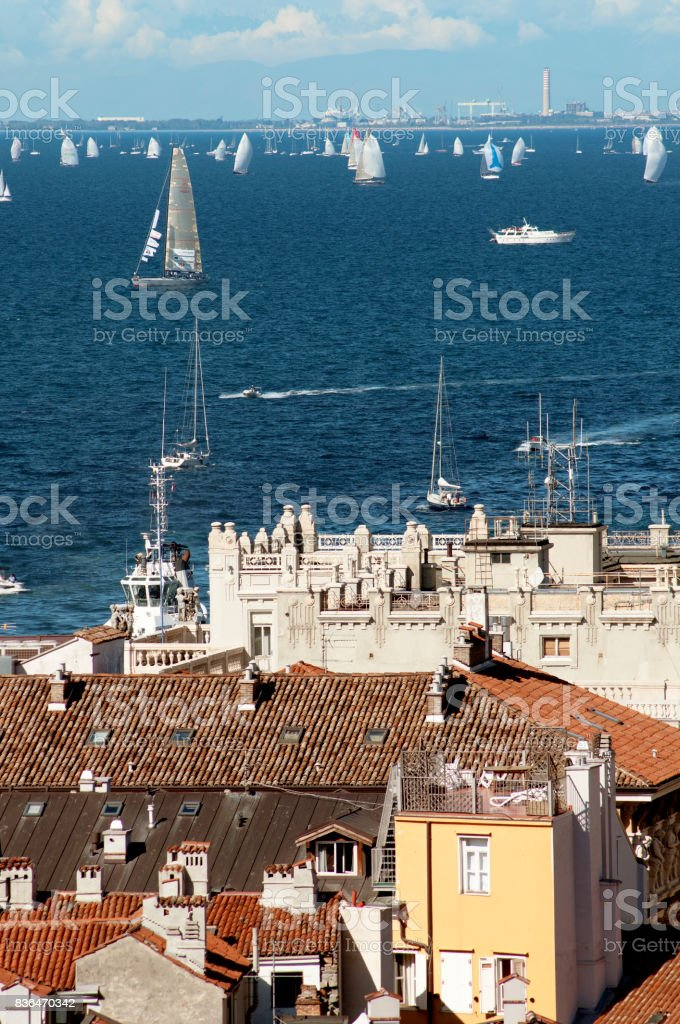 Roofs of Trieste city with the Barcolana regatta stock photo
