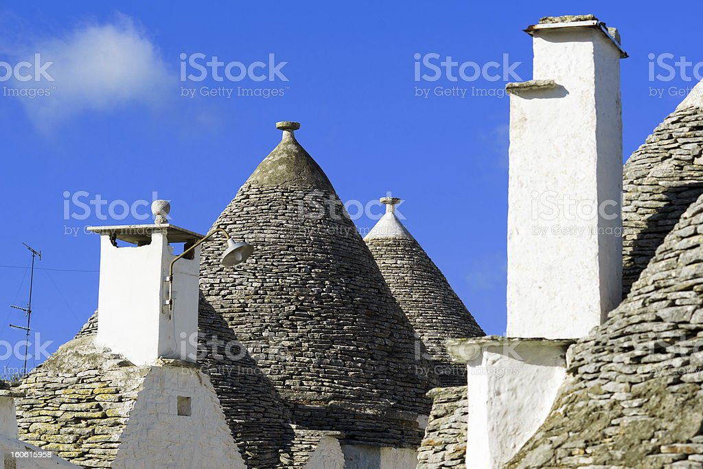 Roofs of Trulli - Traditional stone house in Alberobello, Italy royalty-free stock photo