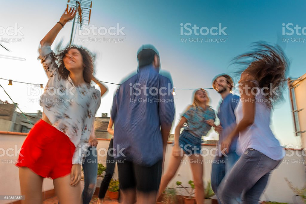 Rooftop dance scene stock photo