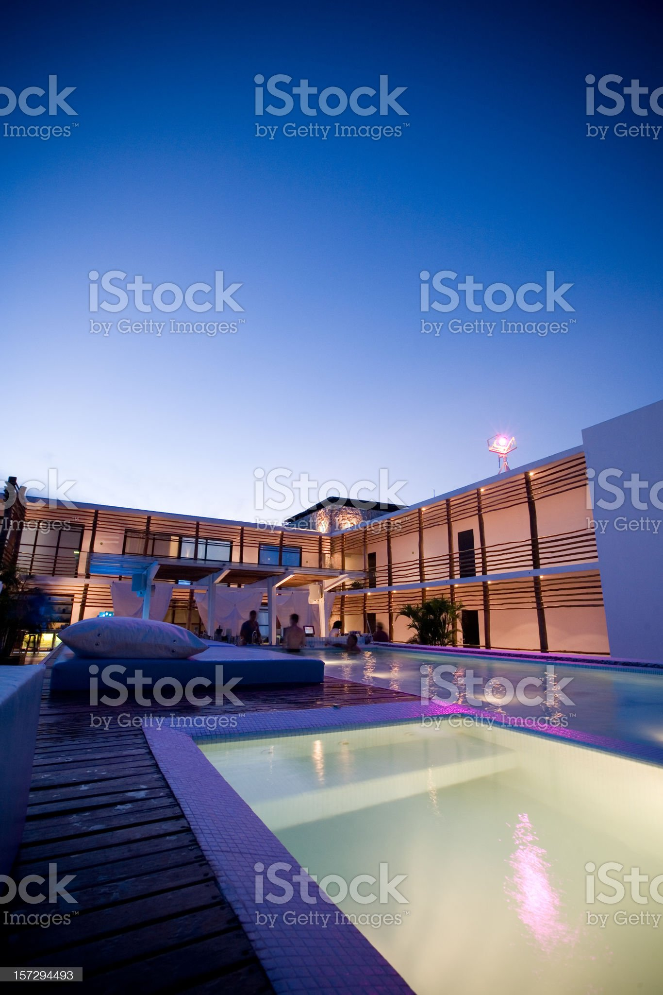 A rooftop lounge at night with a pool royalty-free stock photo