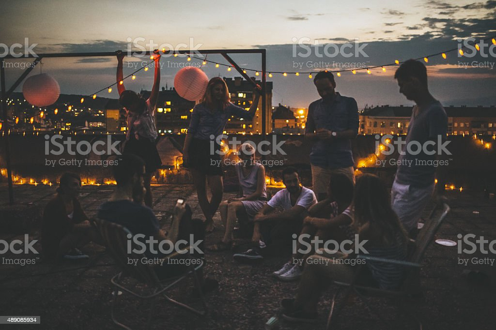 Rooftop party moments stock photo