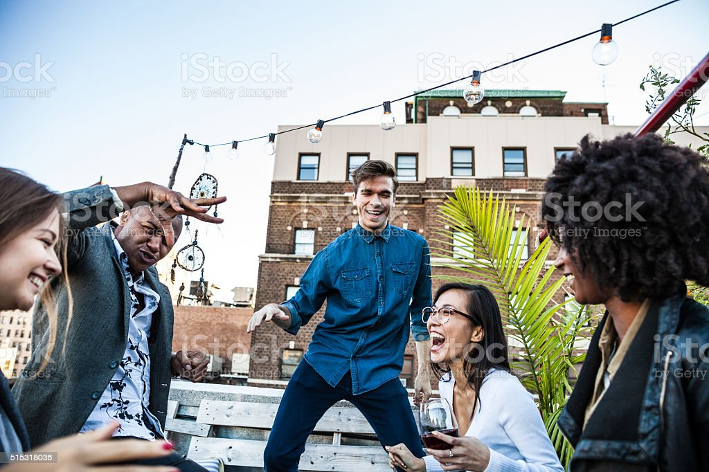 Rooftop party with friends in New York Manhattan stock photo