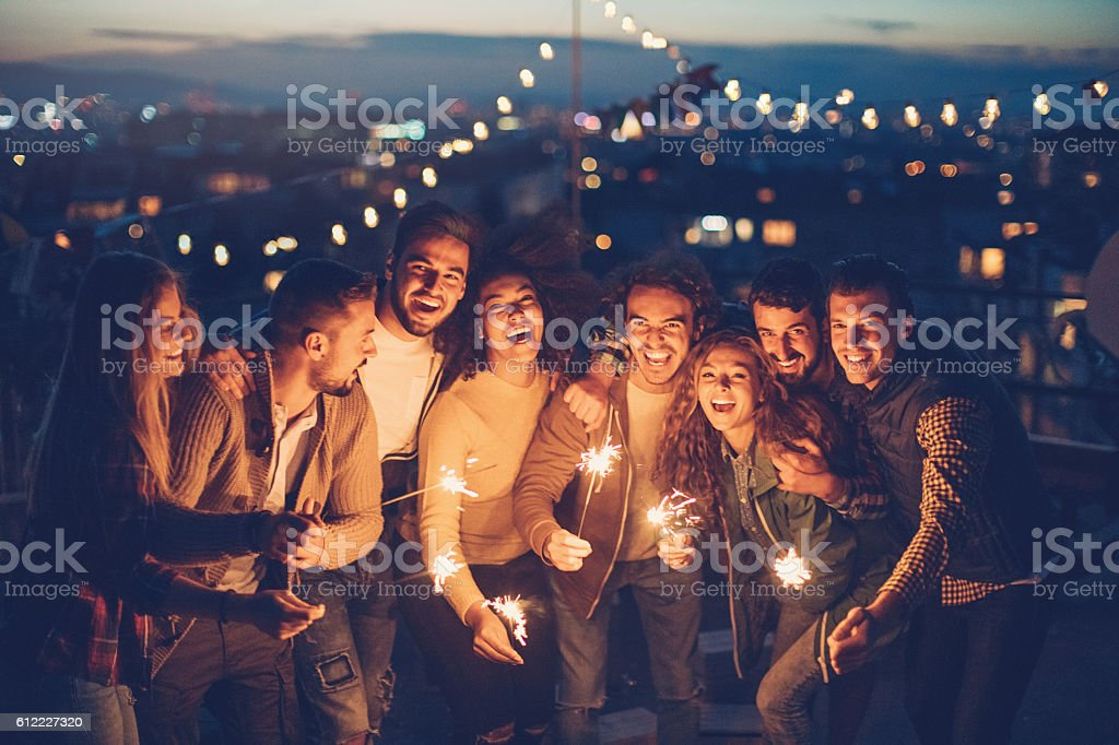 Rooftop party with sparklers at night stock photo