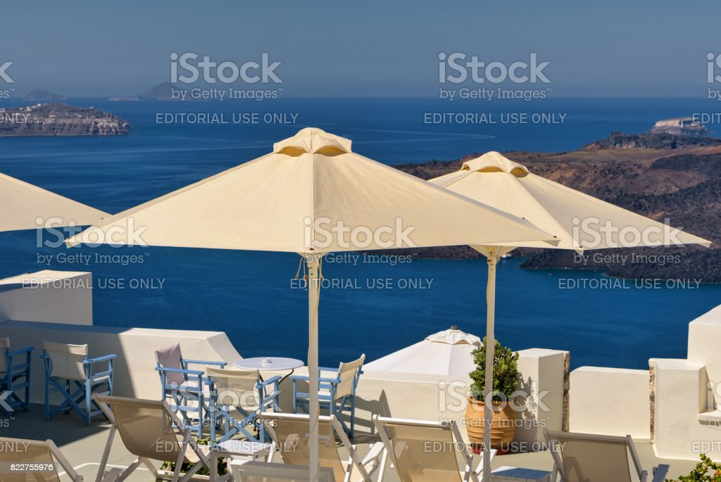 Rooftop patio bar in the island of Santorini with views of the blue Aegean sea. stock photo