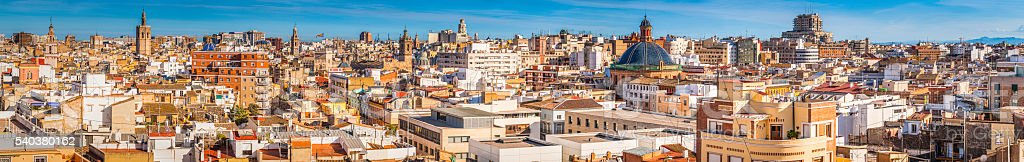 Rooftop terraces domes spires sunset panorama crowded cityscape Valencia Spain stock photo