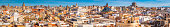 Rooftop terraces domes spires sunset panorama crowded cityscape Valencia Spain