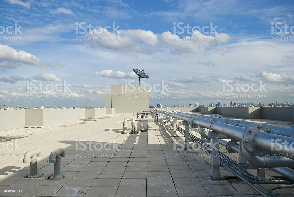 Rooftop with Satellite Dish and Pipe lines stock photo