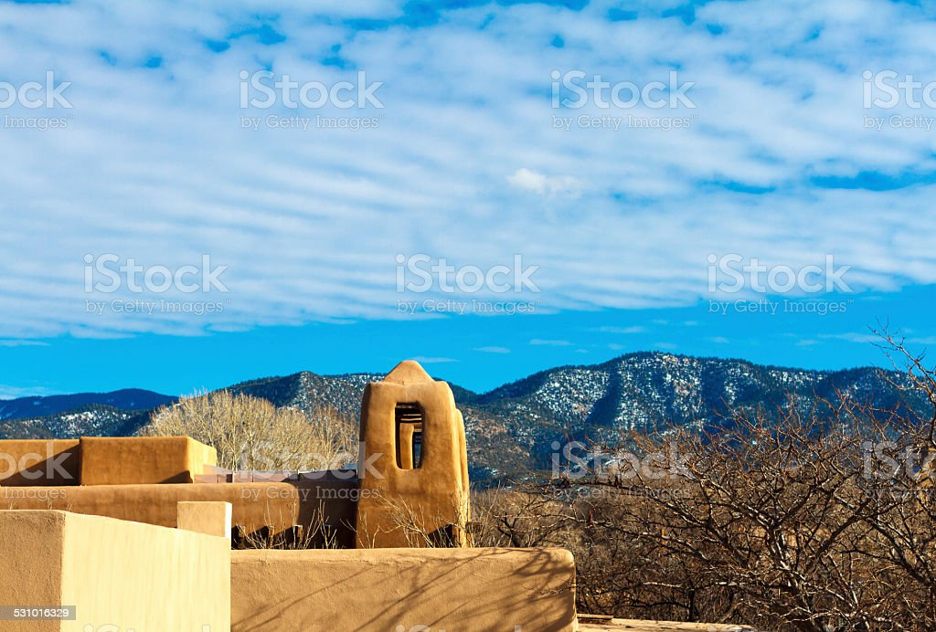 Rooftops and Snowy Hills of Santa Fe, NM stock photo