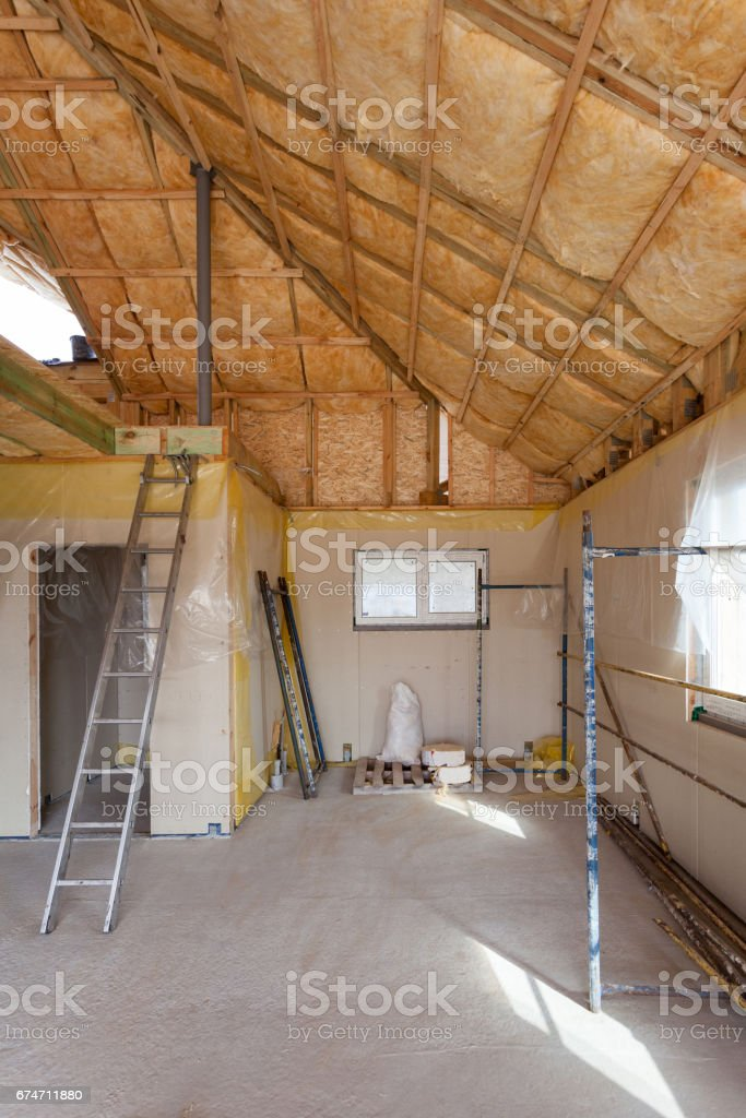 A room at a newly constructed home is sprayed with liquid insulating foam stock photo