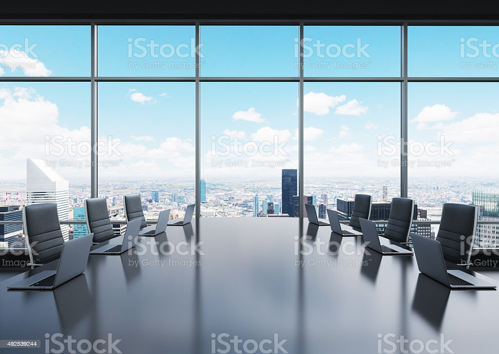 room equipped by laptops in a panoramic office stock photo