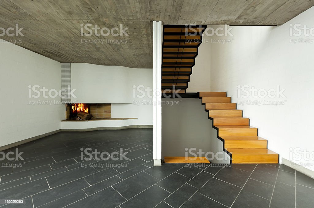 room  fireplace and wooden staircase royalty-free stock photo