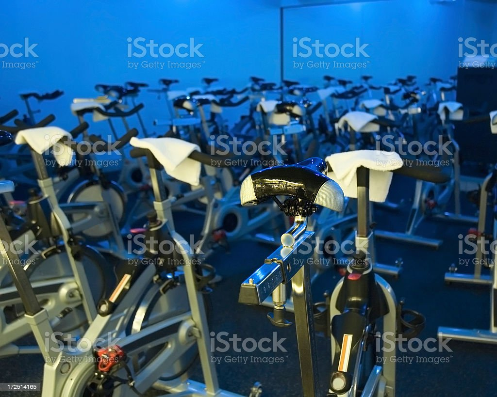 A room full of exercise bicycles stock photo