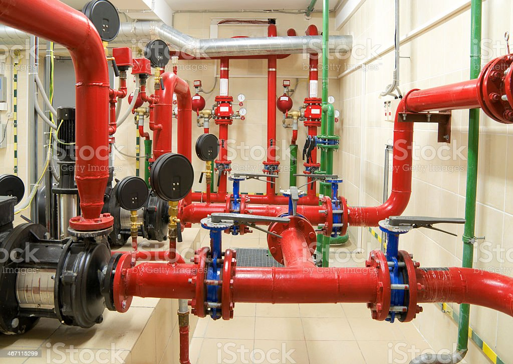 A room full of fire sprinkler piping and valves stock photo