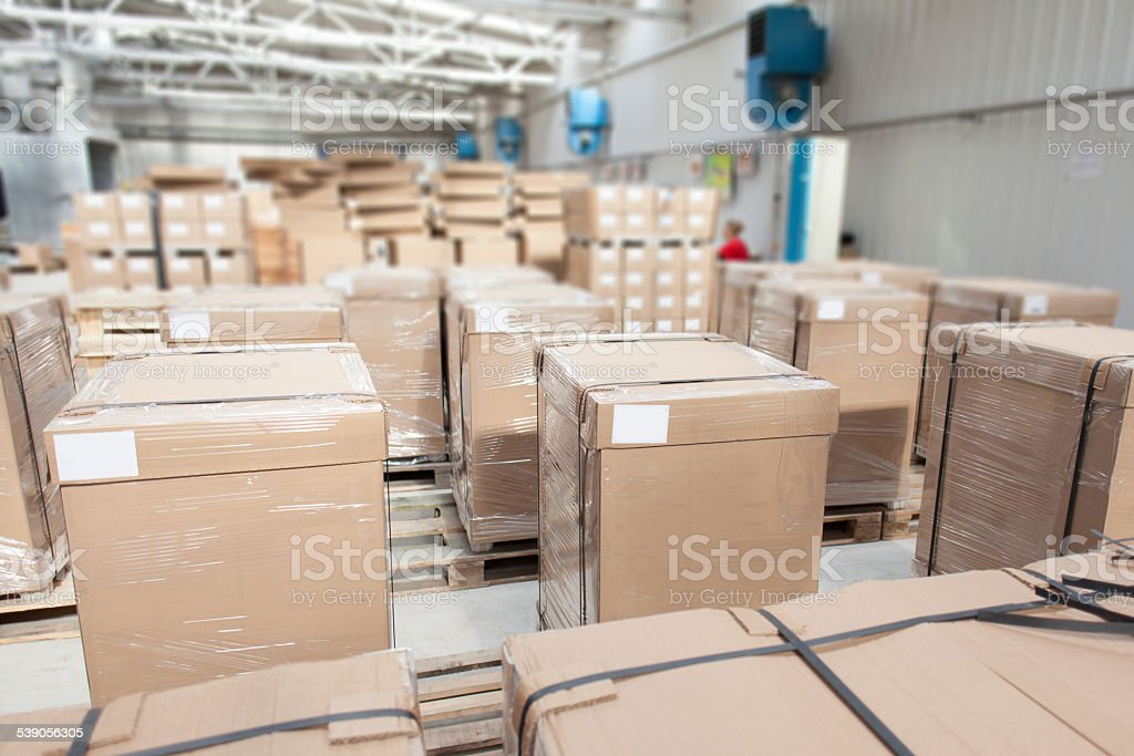 room full of packed boxes stock photo