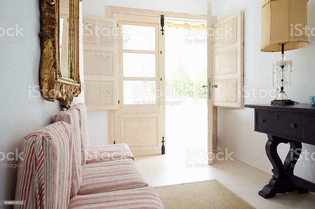 Room In Modern Home With Open French Windows stock photo