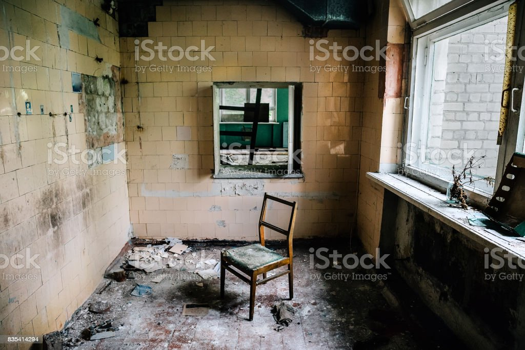 Room inside an old abandoned building, chair stock photo