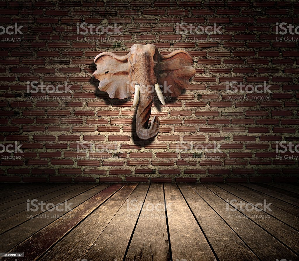 room interior vintage with brown textured wall and Elephant head stock photo