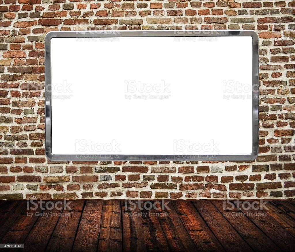Room interior with huge blank billboard on brickwall royalty-free stock photo