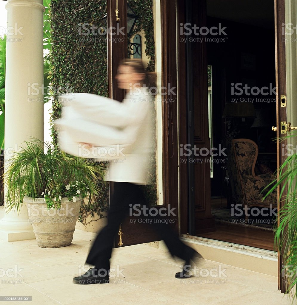 Room service attendant walking with pillows (blurred motion) stock photo