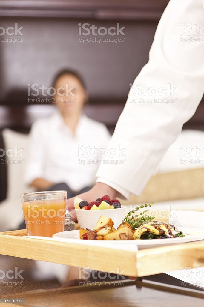 Room service setting down a nice breakfast for hotel guest stock photo