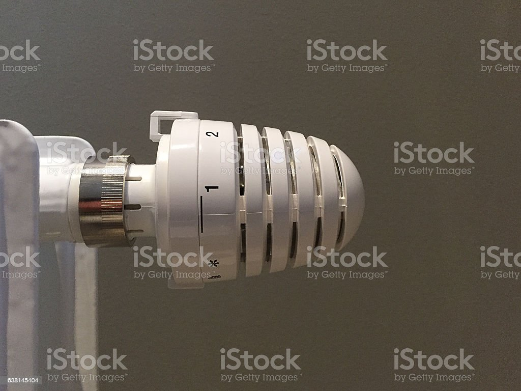 room thermostat of a radiator stock photo