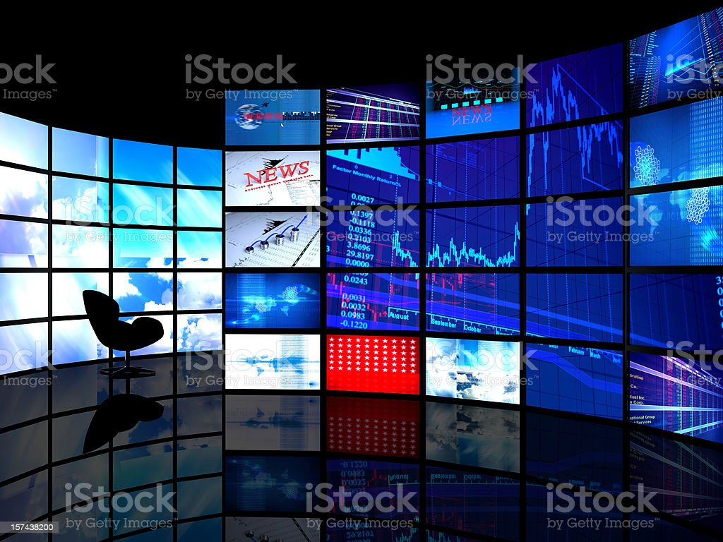 Room with a wall of tv screens stock photo