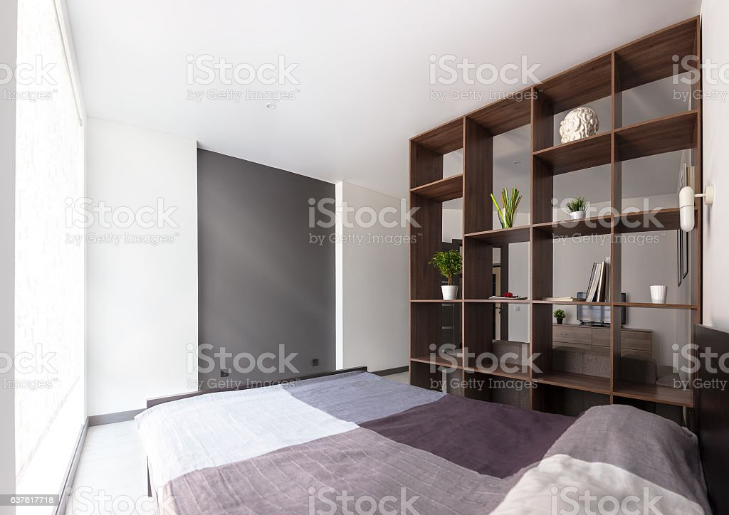 Room with bed and rack stock photo
