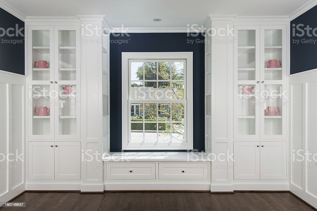 Room With Cabinets And Window stock photo