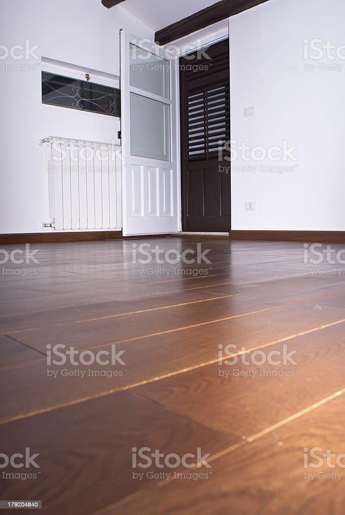 room with hardwood floors stock photo