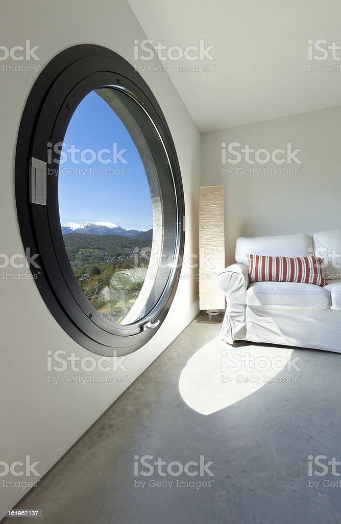 room with large porthole royalty-free stock photo