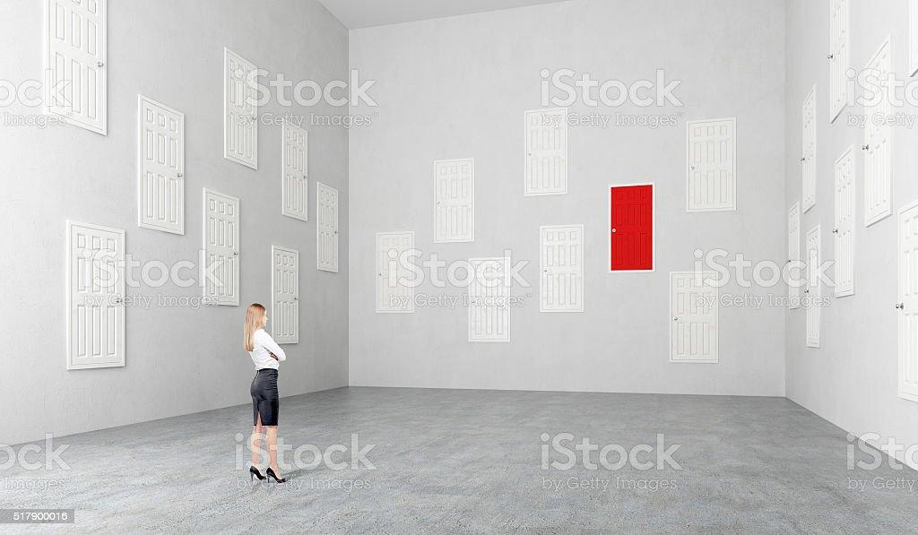 Room with many doors stock photo