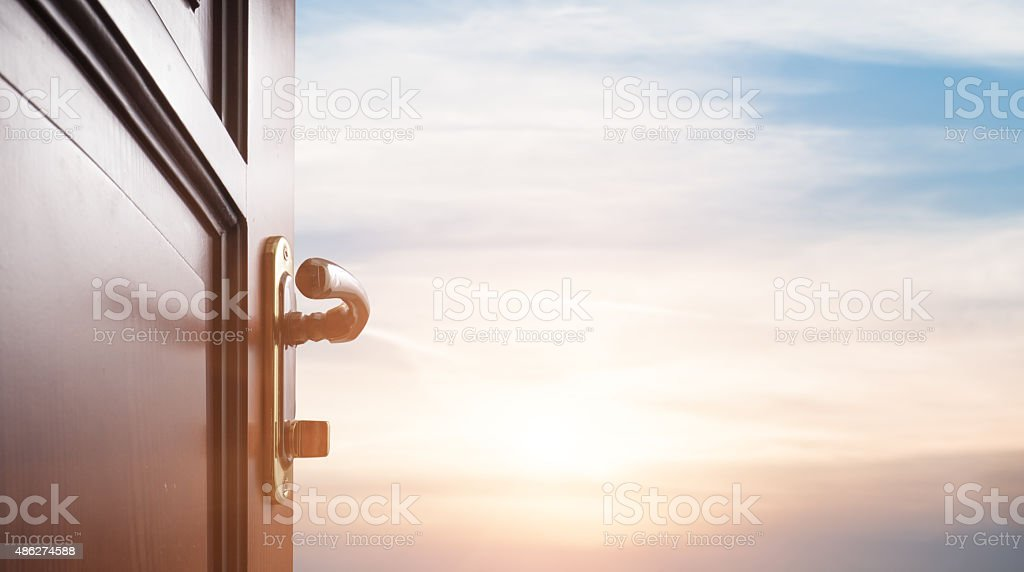 room with open door stock photo